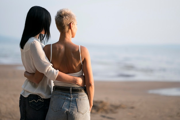 Young lesbian couple looking at sea
