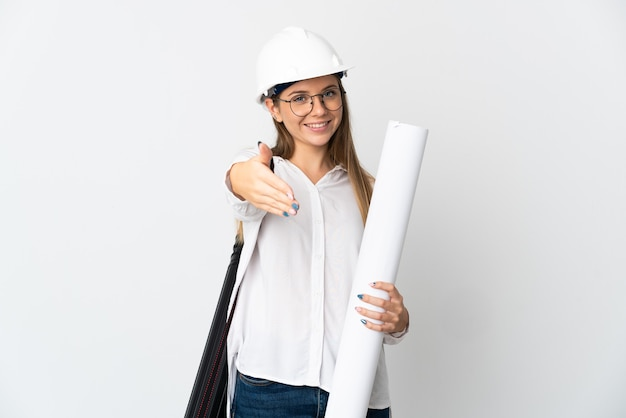 Young lithuanian architect woman with helmet and holding blueprints isolated