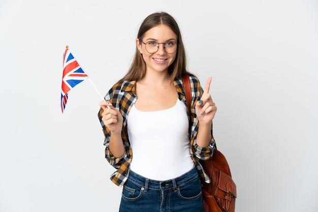 素晴らしいアイデアを指している白い背景で隔離のイギリスの旗を保持している若いリトアニアの女性