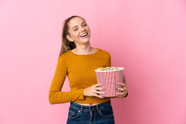 Young lithuanian woman isolated holding a big bucket of popcorns