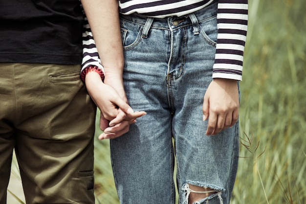 Young love couple holding hands together in vintage color tone