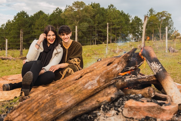 Young loved couple of tourists have a date in the forest