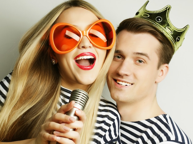 Young lovely couple posing in studio, close up, happy man and happy woman,