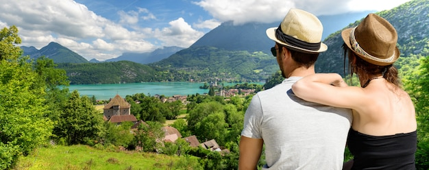 Young lovers couple watching lake of annecy. france