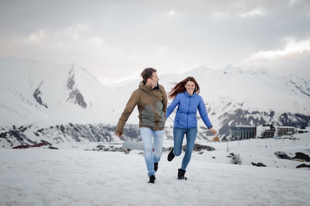 Young lovers spending time and having fun in mountains