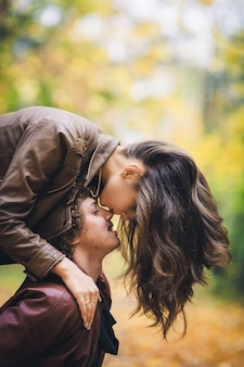 Young loving couple in autumn in park