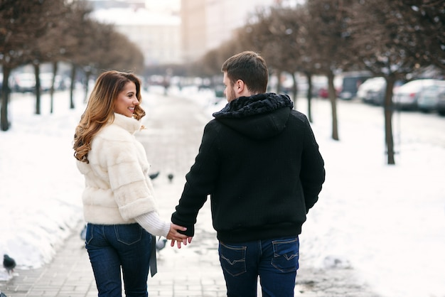 Young loving couple on natural winter . new year and christmas.
