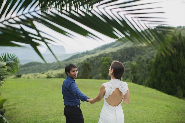 Young loving happy couple on tropical island with palm trees