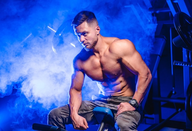 Young male athlete bodybuilder posing.