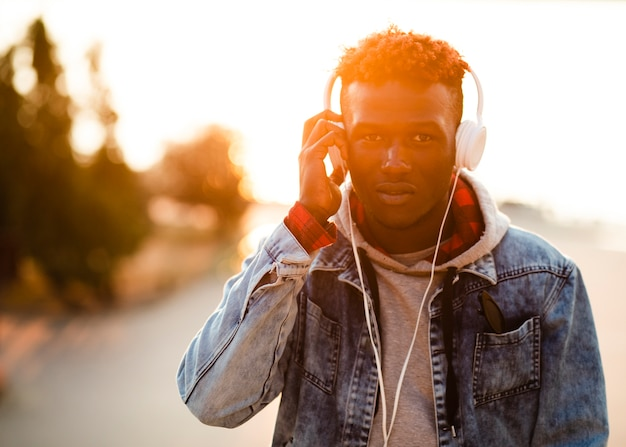 Young male in city listening music