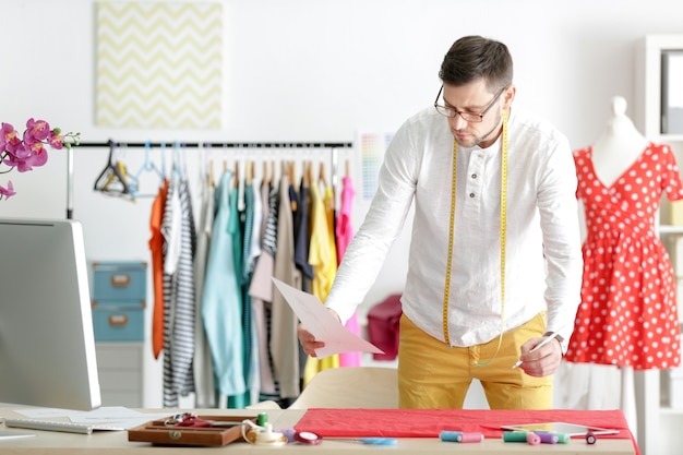 Young male fashion designer at workplace