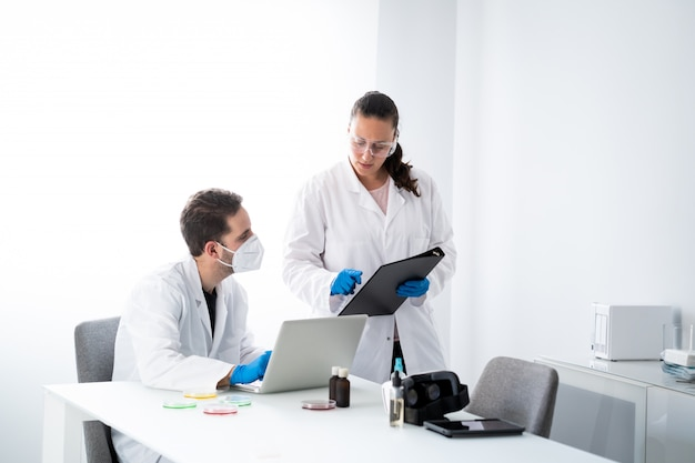 Young male and female doctors are working in the modern biological and biotechnology science laboratory
