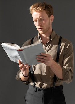 Young male model reading a book