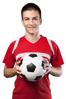 Молодой мужской футболист на белом фоне