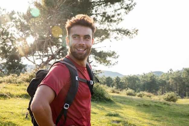 Young male traveler going to hike