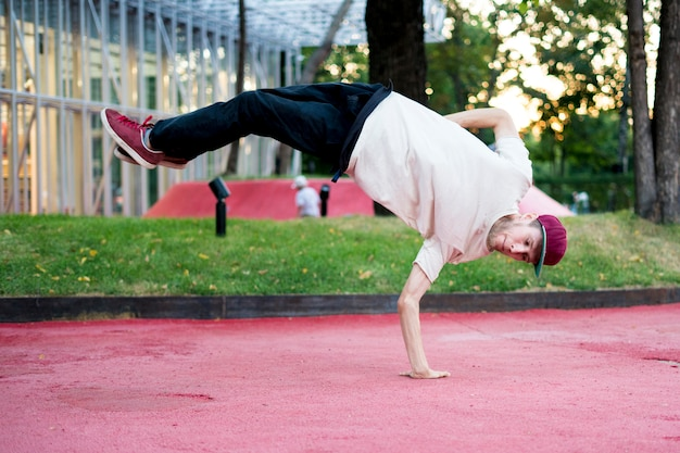 Young man acrobat freedom physical activity in the urban city concept