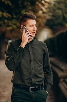 Young man adult student talking on the phone