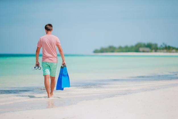 Young man on the beach having fun
