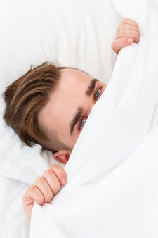 Young man in the bed