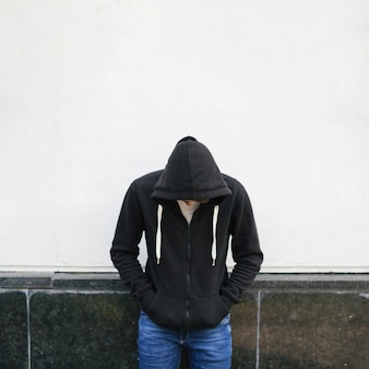 Young man in black hoodie