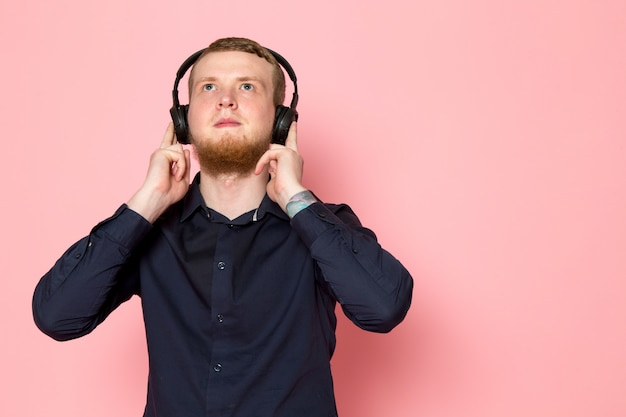Young man in black shirt with black headphones