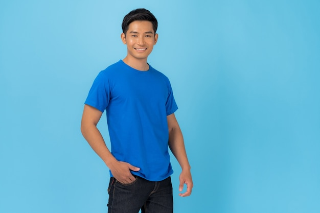 Young man in blue t-shirt isolated on blue
