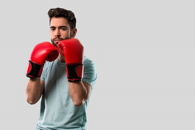 Young man boxing with gloves