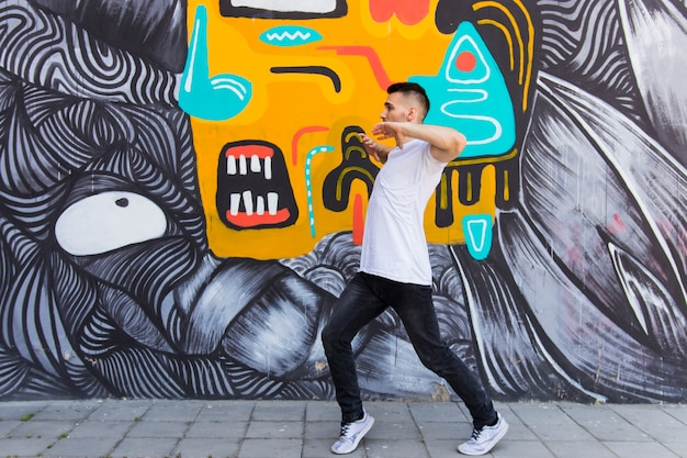 Young man break dancing on creative textured