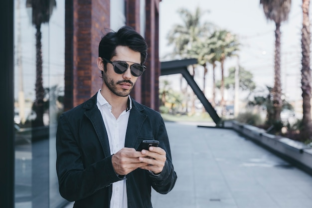 Young man browsing smartphone