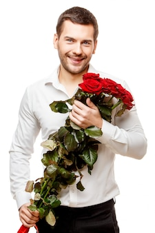 Young man carrying flowers