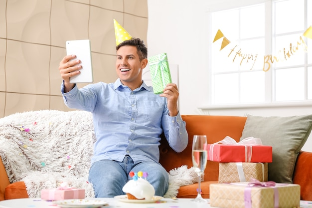 Young man celebrating birthday at home due to coronavirus epidemic