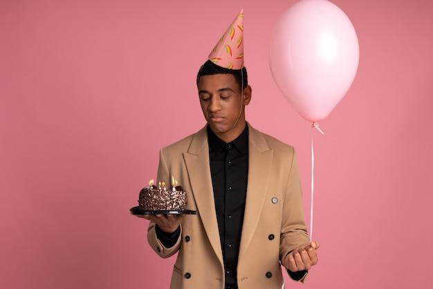 Young man celebrating his birthday