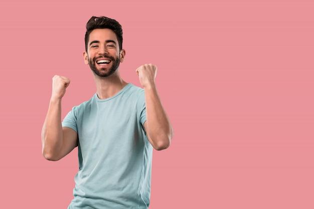 Young man celebrating a success