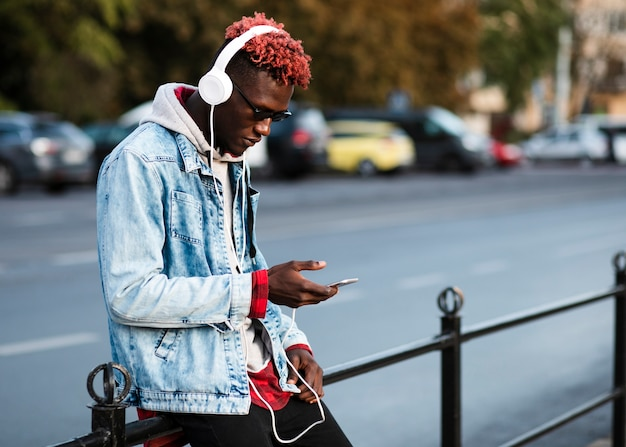 Young man in the city looking at phone