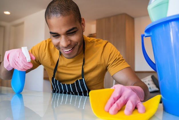 Young man cleaning at home