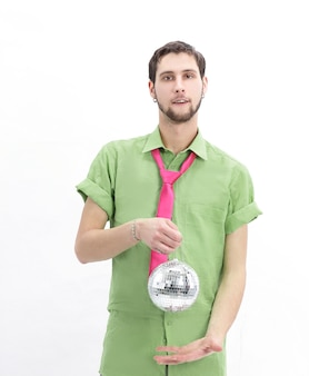 Young man in colorful clothes with a mirror ball.isolated on white wall