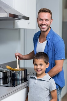 Young man cooking spaghetti