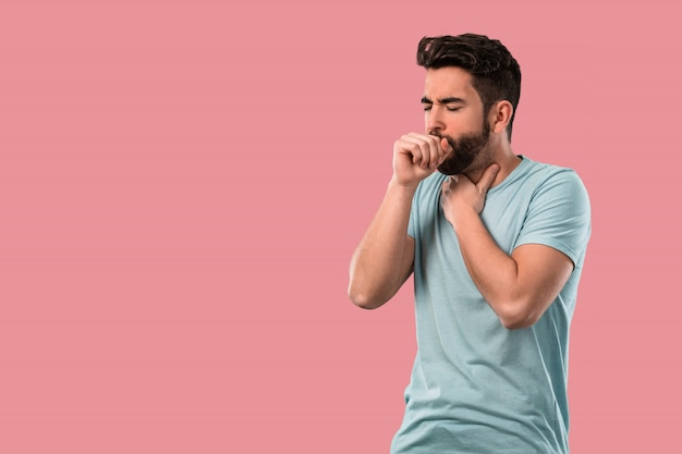 Young man coughing and sick