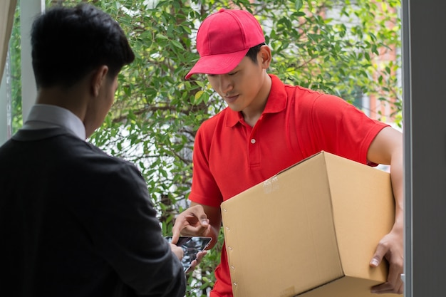 Young man delivering package to customer at home. delivery