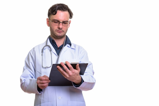 Young man doctor reading on clipboard