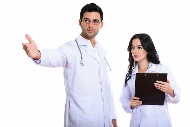 Young man doctor showing something and woman doctor