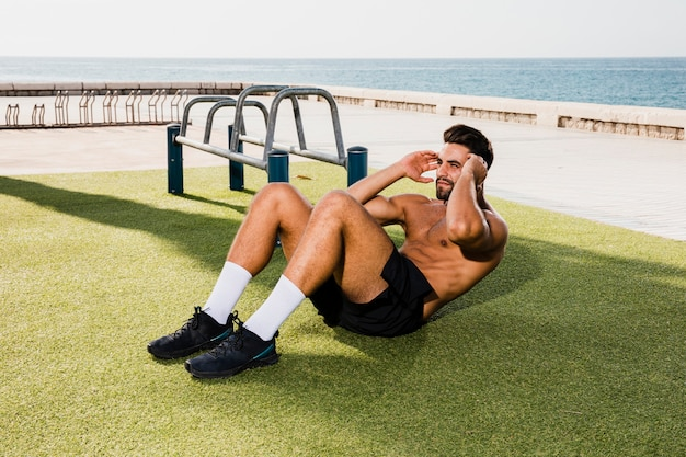 Young man doing abs morning routine