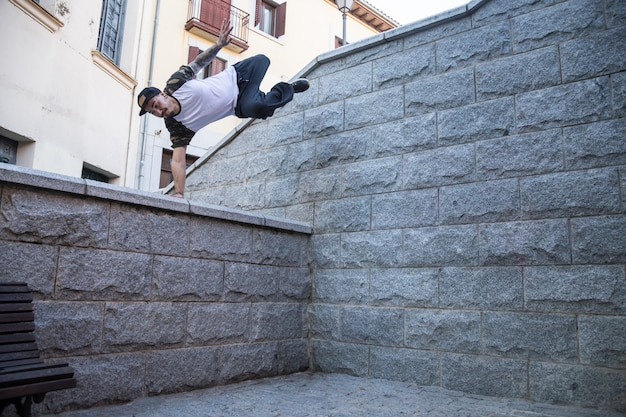 Young man doing an amazing parkour trick on the street