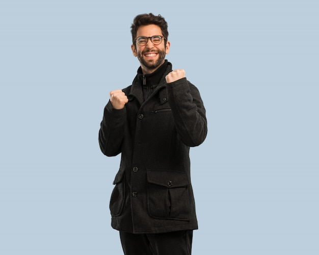 Young man doing gesture of success