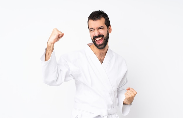 Young man doing karate celebrating a victory