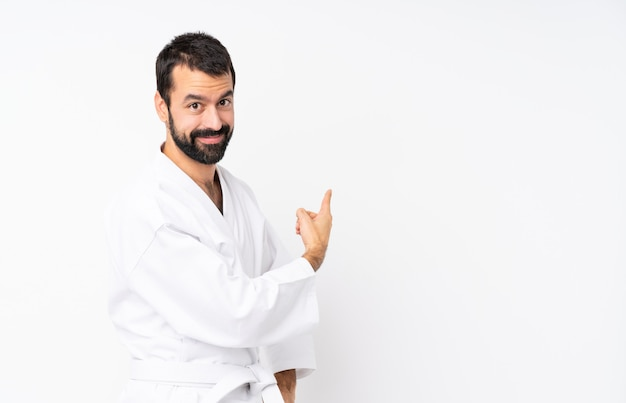 Young man doing karate pointing back