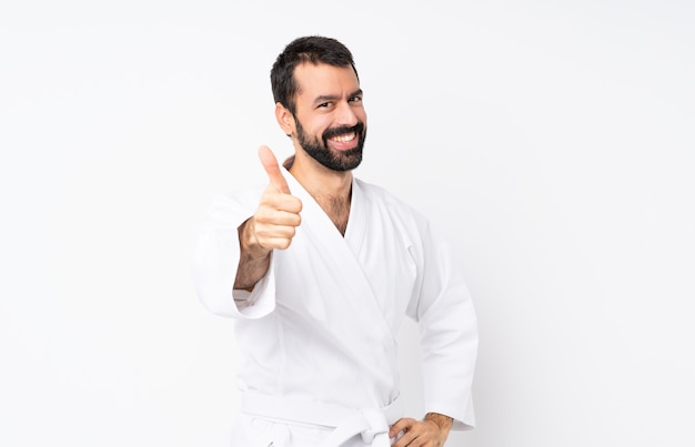 Young man doing karate with thumbs up because something good has happened