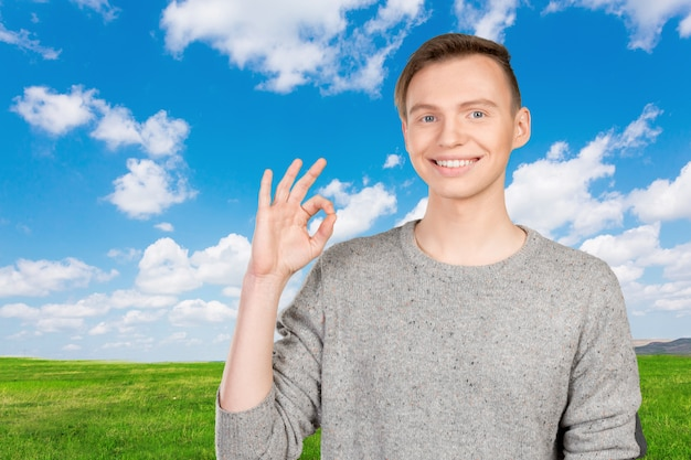 Young man doing an okay gesture
