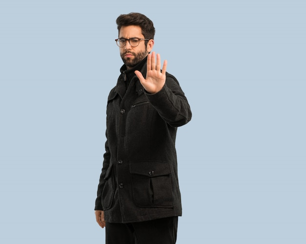 Young man doing stop gesture