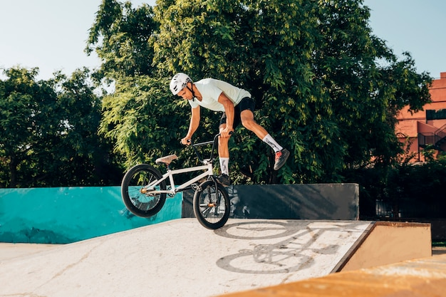 Young man doing tricks with bmx bike